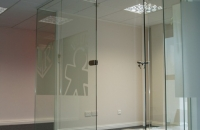 Frameless glass partition and doors