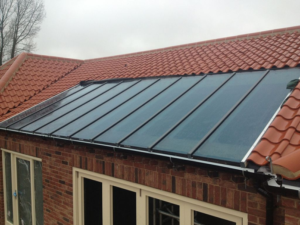 Glazed roof overhead glazed roof systems from sunlite for Glass roof design