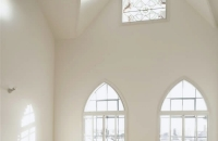 Secondary glazing in arched and curved windows