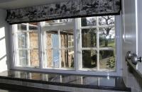 Secondary glazing in kitchen slider window