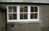 upvc white vertical sliding windows with face fret bars
