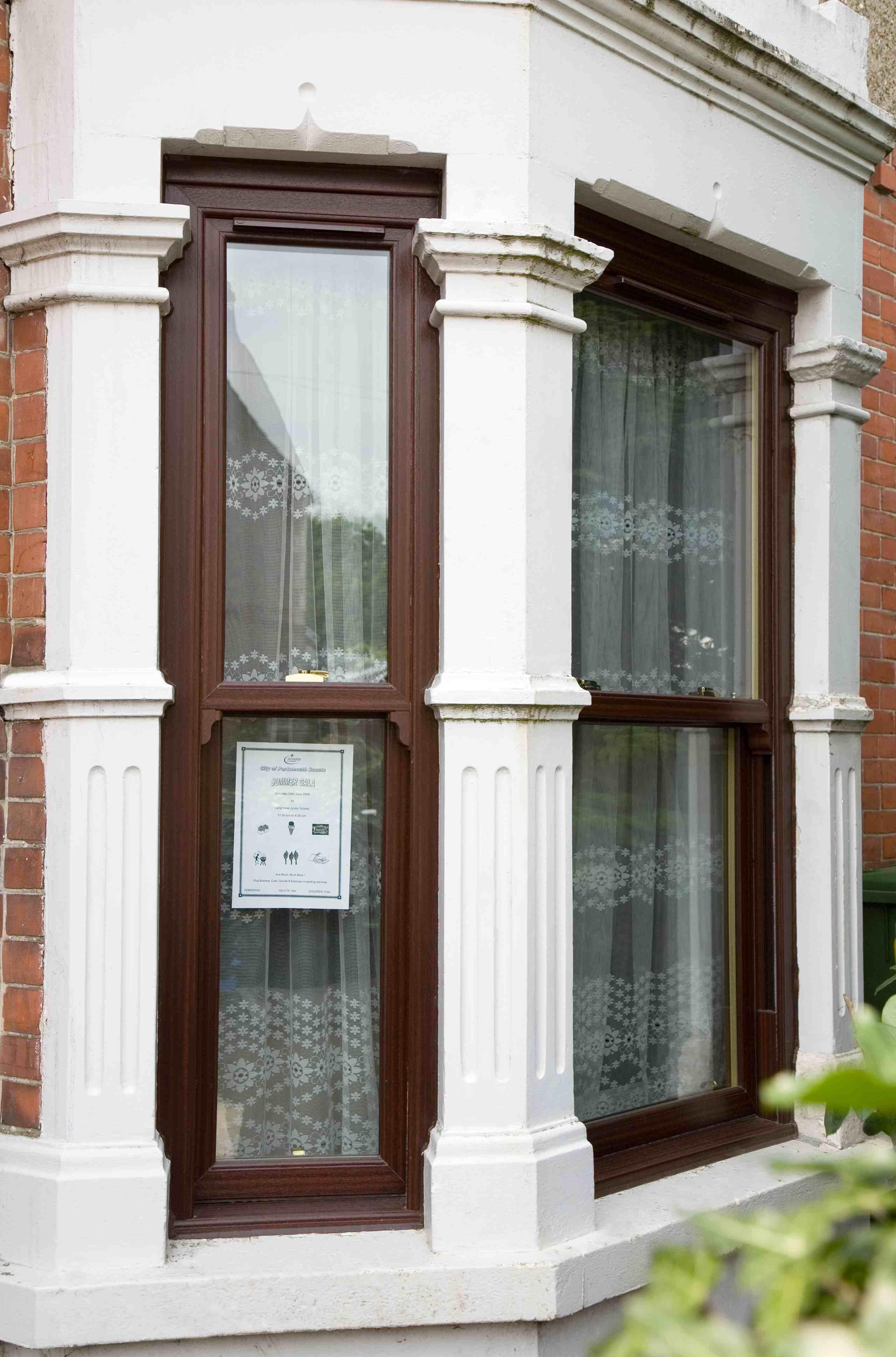 Upvc rosewood vertical sliding window glass glazing for Vertical sliding window design