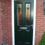 Dark green glazed composite door