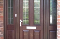 upvc panelled rosewood front-door and sidelights