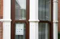 upvc rosewood vertical sliding window